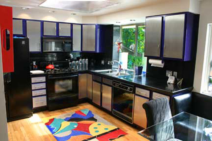 Kitchen with skylight and cobalt blue cabinets